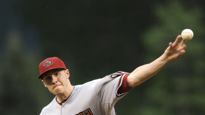 Arizona Diamondbacks starting pitcher Patrick Corbin throws against the Colorado Rockies during the first inning of a baseball game on Monday, May 20, 2013, in Denver. (AP Photo/Jack Dempsey)