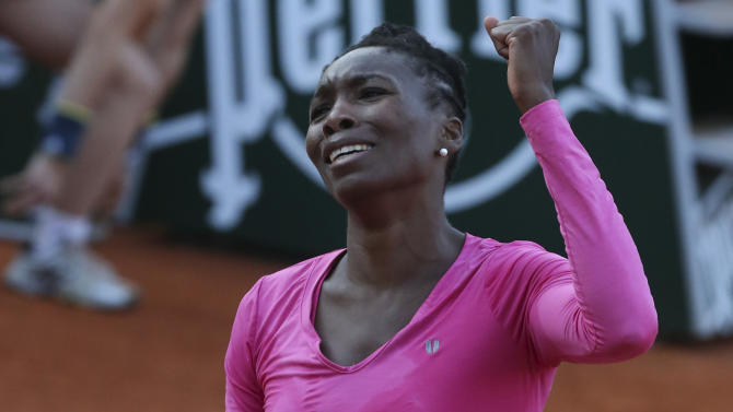 Venus Williams of the U.S. clenches her fist after winning the second set against Poland's Urszula Radwanska in their first round match of the French Open tennis tournament, at Roland Garros stadium in Paris, Sunday, May 26, 2013. (AP Photo/Michel Euler)