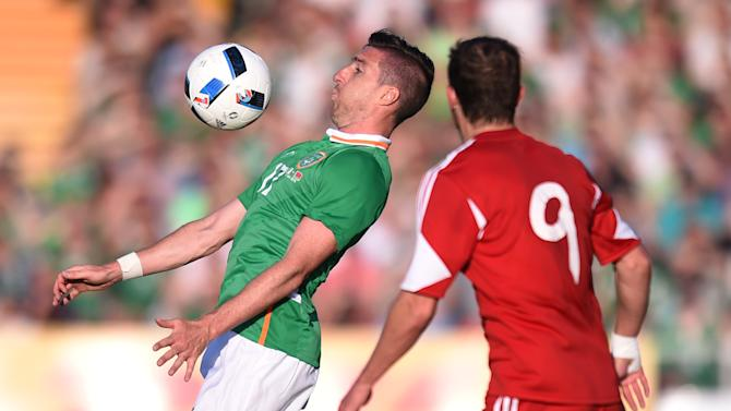 Republic of Ireland's Stephen Ward in action with Belarus' Ihar Stasevich