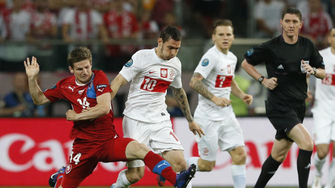 Czech Republic's Vaclav Pilar, left, and Poland's Ludovic Obraniak go for the ball during the Euro 2012 soccer championship Group A match between Czech Republic and Poland in Wroclaw, Poland, Saturday, June 16, 2012. (AP Photo/Petr David Josek)