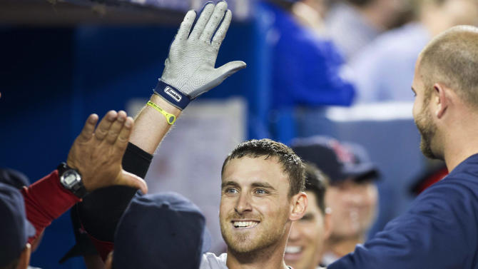 Boston Red Sox Will Middlebrooks celebrates in the dugout after hitting a home run off Toronto Blue Jays pitcher Dave Bush during seventh inning AL baseball action in Toronto on Sunday April 7, 2013. (AP PHOTO/THE CANADIAN PRESS,Chris Young)