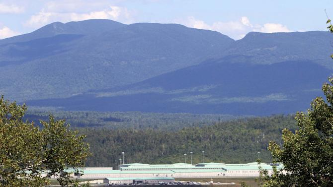 In this photo taken Thursday, Aug. 9, 2012, the newly built federal prison is seen tucked away in the mountains in Berlin, N.H. The city is hoping  to get out of its steep economic depression with new jobs, some created by the prison. (AP Photo/Jim Cole)