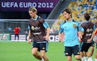 Spain's Fernando Torres (L) and David Silva warm up during a team training session on June 30. Euro 2012 reaches its climax in Sunday's final in Kiev, when defending champions Spain will bid to hold off an Italy side who have steadily eased into form in trademark fashion