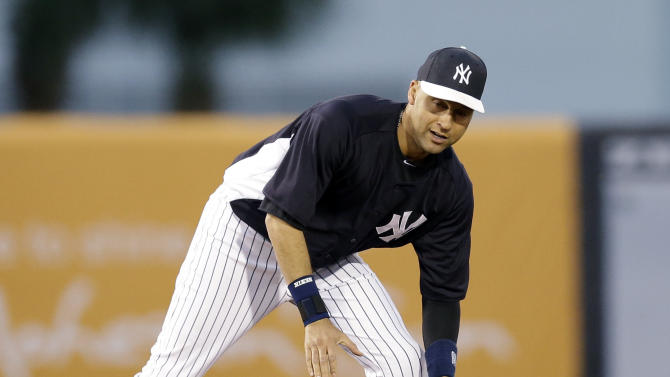 New York Yankees shortstop Derek Jeter (2) fields a ball between innings in an exhibition spring training baseball game against the Philadelphia Phillies in Tampa, Fla., Wednesday, March 13, 2013. (AP Photo/Kathy Willens)