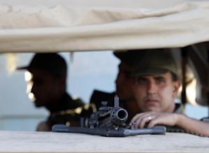 Tunisian army soldiers guard the street near the attacked…