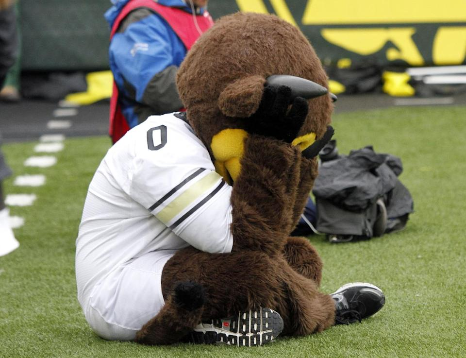 Colorado's mascot Chip, a buffalo, sits on the sideline with head in hands after an Oregon touchdown during the first half of an NCAA college football game in Eugene, Ore., Saturday, Oct. 27, 2012. (AP Photo/Don Ryan)
