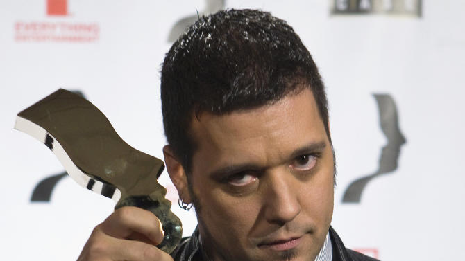 This Nov. 28, 2008 file photo, George Stroumboulopoulos poses for a photograph after winning best host during the 23rd Annual Gemini Awards in Toronto. It's a safe bet that Stroumboulopoulos will be the first male CNN personality to wear two earrings and a skull ring from the same designer who made one for Keith Richards. Stroumboulopoulos, whose new nighttime talk show premieres Sunday, June 9, 2013 is more curious than dangerous, though.  (AP Photo/The Canadian Press, Nathan Denette)