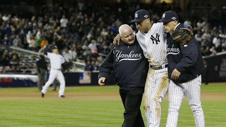 Trainer Steve Donohue, left, and New York Yankees manager Joe Girardi, right, help Derek Jeter off the field after he injured himself during Game 1 of the American League championship series against the Detroit Tigers Sunday, Oct. 14, 2012, in New York. (AP Photo/Paul Sancya )