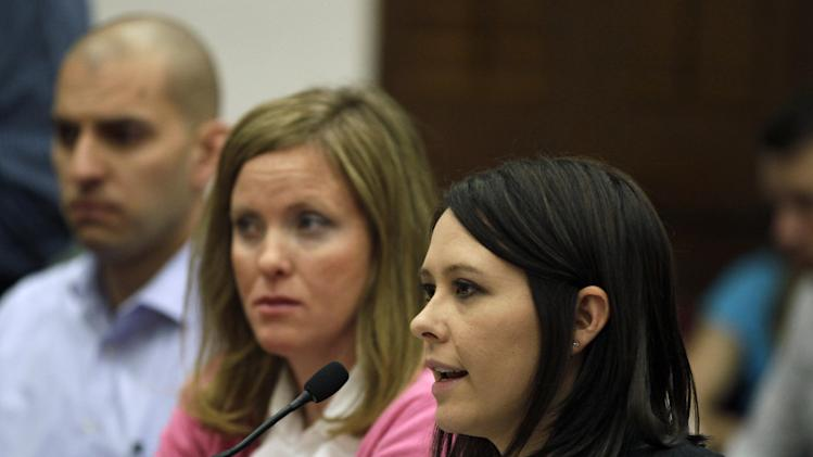 Krista Ceresa, right, whose mother, Ginny May, was murdered by Gary Davis in 1986, testifies against gun control legislation in the Colorado Legislature, at the State Capitol, in Denver, Monday, March 4, 2013. State Senate committees began work Monday on a package of gun-control measures that already have cleared the House which include limits on ammunition magazine sizes and expanded background checks to include private sales and online purchases. (AP Photo/Brennan Linsley)