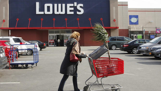 In this Feb 21, 2012, a customer shops at Lowe's, in New York. Lowe's Cos. said Mondauy, Feb. 27. 2012, its fourth-quarter net income rose 13 percent on an 11 percent rises in revenue as it benefited from an extra week in the period. (AP Photo/Mark Lennihan)