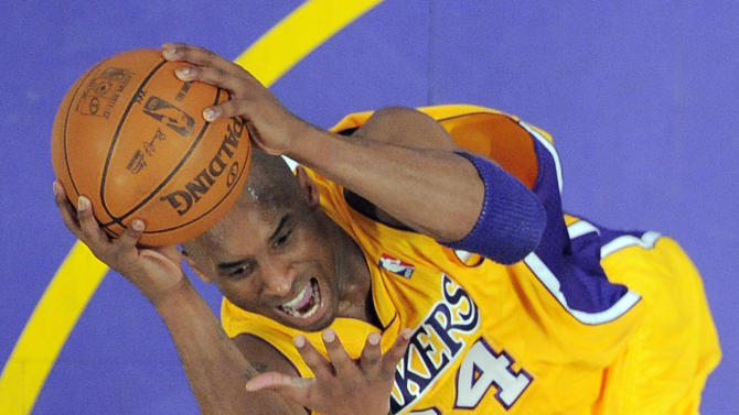 Los Angeles Lakers guard Kobe Bryant, top, goes up for a shot as Denver Nuggets guard Arron Afflalo defends during the first half of Game 7 in their first-round NBA basketball playoff series, Saturday, May 12, 2012, in Los Angeles. (AP Photo/Mark J. Terrill)