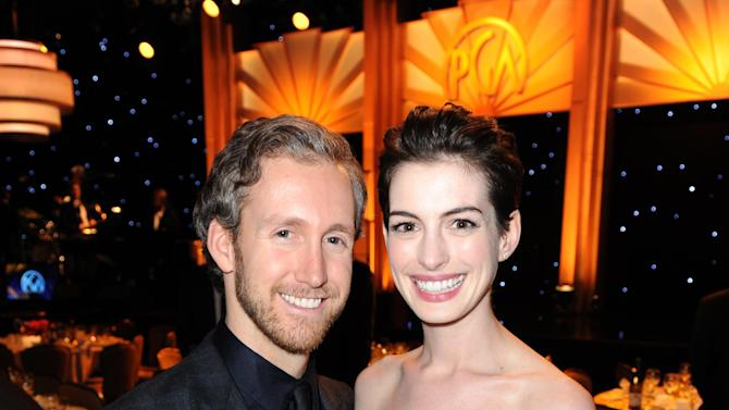 IMAGE DISTRIBUTED FOR THE PRODUCERS GUILD - Anne Hathaway, right, and Adam Shulman are seen in the audience at the 24th Annual Producers Guild (PGA) Awards at the Beverly Hilton Hotel on Saturday Jan. 26, 2013, in Beverly Hills, Calif. (Photo by Jordan Strauss/Invision for Producers Guild/AP Images)