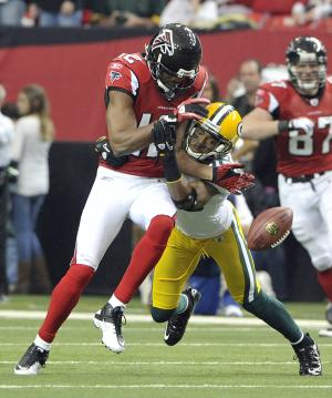 Green Bay Packers defender Tramon Williams (38) breaks up a pass to Atlanta Falcons receiver Michael Jenkins (12) in the first quarter of an NFL football game at the Georgia Dome in Atlanta on Sunday, Nov. 28, 2010. (AP Photo/Rich Addicks)
