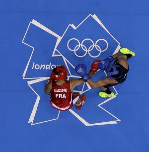France's Rachid Azzedine and USA's Jose Ramirez fight in a men's light 60-kg boxing match at the 2012 Summer Olympics, Sunday, July 29, 2012, in London. (AP Photo/Morry Gash)