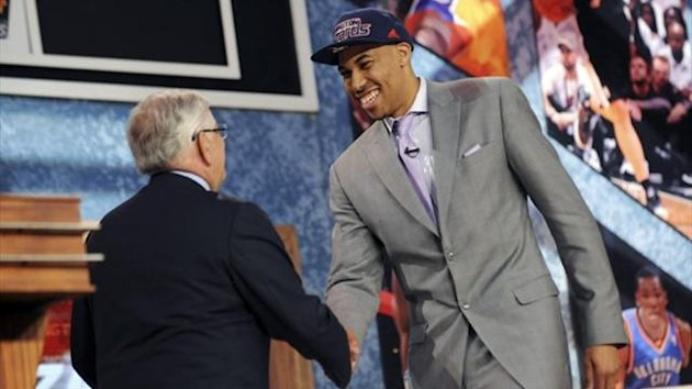 Otto Porter Jr. from Georgetown University shakes hands with NBA Commissioner David Stern (L) after being selected by the Washington Wizards as the third overall pick in the 2013 NBA Draft in Brooklyn (Reuters)