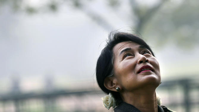 Myanmar's opposition leader and Nobel laureate Aung San Suu Kyi takes a walk after paying tribute at the memorial of India's first Prime Minister Jawaharlal Nehru on his birth anniversary in New Delhi, India, Wednesday, Nov. 14, 2012. Suu Kyi is on a six-day visit to India.  (AP Photo/ Manish Swarup)