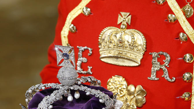 The Imperial State Crown is carried on a cushion as it arrives for the State Opening of Parliament, at the Houses of Parliament in London, Wednesday, May 8, 2013. The State Opening of Parliament marks the formal start of the parliamentary year, the Queen will deliver a speech which will set out the government's agenda for the coming year. (AP Photo/Kirsty Wigglesworth, Pool)