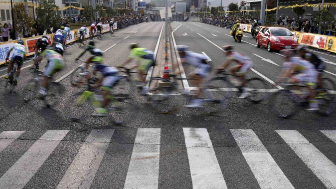 Riders turn a corner during Point Race 2 at the Tour de France Saitama Criterium race in Saitama