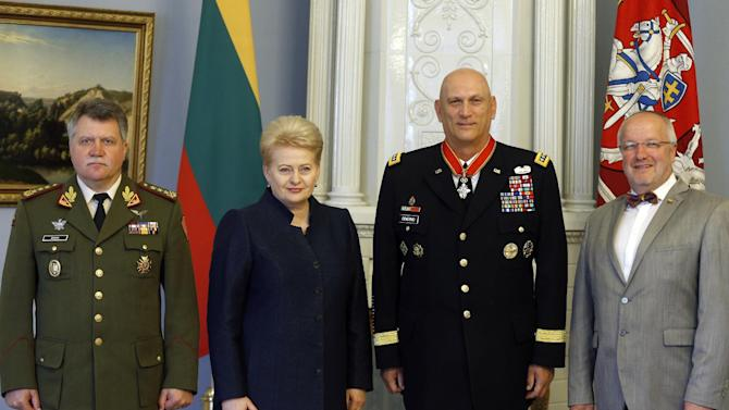 U.S. Army Chief of Staff Gen. Raymond Odierno, second from right, poses with Lithuanian President Dalia Grybauskaite, second from left, Lithuanian Minister of National Defense Juozas Olekas, right, and Lithuania's Chief of Defense Lt. Gen. Jonas Vytautas Zukas for photographers after receiving State Awards of the Republic of Lithuania, the Grand Cross of Commander of the Order for Merits to Lithuania, at the president's palace in Vilnius, Lithuania, Tuesday, July 7, 2015. (AP Photo/Mindaugas Kulbis)