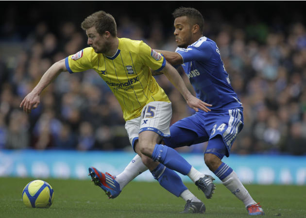 Chelsea's Ryan Bertrand, right, competes with Birmingham City's Wade Elliott during their English FA Cup fifth round soccer match at Stamford Bridge, London, Saturday, Feb. 18, 2012. (AP Photo/Sang Ta
