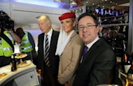 "Qantas chief Alan Joyce (R) and Emirates President Tim Clark (3rd R) on board an Emirates aircraft at Sydney Airport. ""It is far bigger than a codeshare. Or even a joint services agreement. This is the biggest arrangement Qantas has ever entered into with another airline,"" Joyce said"
