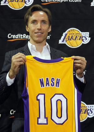 Newly-acquired Los Angeles Lakers guard Steve Nash holds up his new jersey during a news conference at the team's headquarters in El Segundo, Calif., Wednesday, July 11, 2012. The Lakers acquired two-time MVP Nash from the Phoenix Suns in exchange for first round draft picks in 2013 and 2015 as well as second round draft picks in 2013 and 2014.(AP Photo/Reed Saxon)