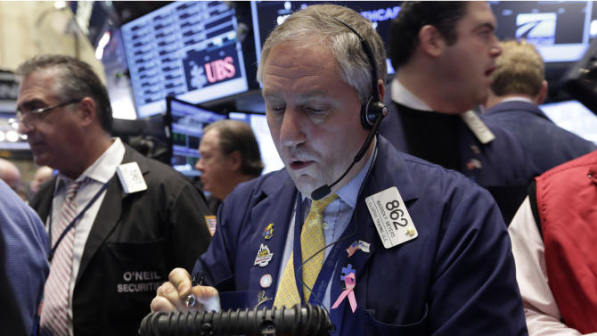 Trader Warren Meyers, center, works on the floor of the New York Stock Exchange, Wednesday, Dec. 18, 2013. Stocks were modestly higher in early trading on Wall Street Wednesday as the Federal Reserve ends its last two-day policy meeting of 2013. Homebuilder stocks rose sharply after the government reported that construction of new homes surged in November. (AP Photo/Richard Drew)