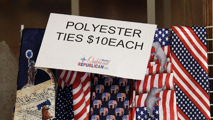 Patriotic ties are for sale at the San Marino Club, Saturday, Feb. 25, 2012, in Troy, Mich., where Republican presidential candidate, former Pennsylvania Sen. Rick Santorum and other presidential candidates campaign. (AP Photo/Eric Gay)