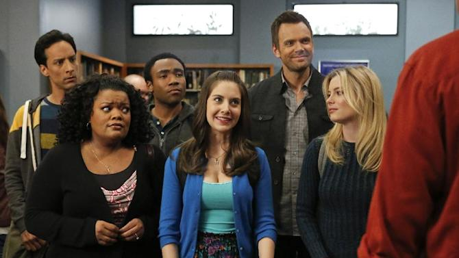 """This TV publicity image released by NBC shows, from left, Danny Pudi as Abed, Yvette Nicole Brown as Shirley, Donald Glover as Troy, Alison Brie as Annie, Joel McHale as Jeff Winger, Gillian Jacobs as Britta in a scene from season four of """"Community."""" NBC said Monday, June 10, 2013, that show creator Dan Harmon will be joined by another former """"Community"""" producer, Chris McKenna.Harmon was replaced as showrunner for season four after a clash with then-cast member Chevy Chase. (AP Photo/NBC, Vivian Zink)"""