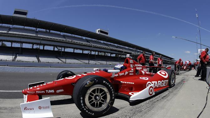 In this photo taken with a fisheye lens, Scott Dixon, of New Zealand, pulls out of the pit area during practice for the Indianapolis 500 auto race at the Indianapolis Motor Speedway in Indianapolis, Monday, May 13, 2013. (AP Photo/Darron Cummings)