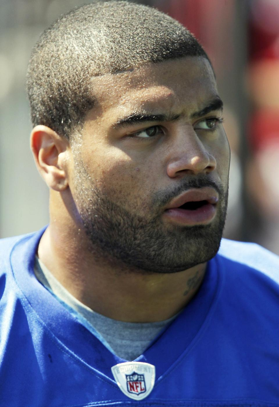 Buffalo Bills' Shawne Merriman looks on during NFL football training camp in Pittsford, N.Y., Saturday, July 30, 2011. (AP Photo/David Duprey)