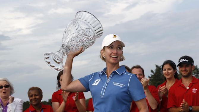 Karrie Webb, of Australia, holds up the trophy after winning the ShopRite LPGA Classic golf tournament in Galloway Township, N.J., Sunday, June 2, 2013. Shanshan Feng, of China, came in second. (AP Photo/Mel Evans)