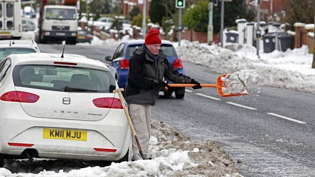 A man digs out his car from snow in Belfast (Reuters)