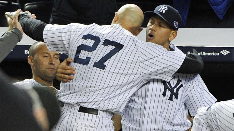New York Yankees' Alex Rodriguez, right, hugs Raul Ibanez (27) as Derek Jeter watches at left after Ibanez pinch-hit a home run in place of Rodriguez during the ninth inning of Game 3 of their American League division baseball series against the Baltimore Orioles, Wednesday, Oct. 10, 2012, in New York. The Yankees won 3-2. (AP Photo/Bill Kostroun)