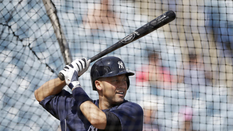 New York Yankees' Derek Jeter takes batting practice during a workout at baseball spring training, Wednesday, Feb. 20, 2013, in Tampa, Fla. (AP Photo/Matt Slocum)