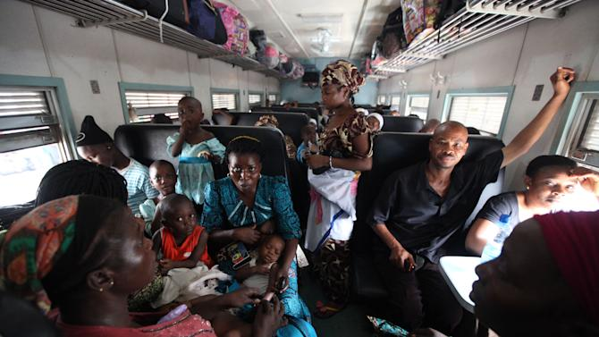 Passengers traveling to Kano seated inside a train in Lagos, Nigeria  Friday, Dec. 21, 2012. Nigeria has built railroad tracks connecting its commercial heartbeat in the south to its largest city in the north, in a bid to revive Africa's most populous moribund railway system. Minister of Transport Idris Umar said at Lagos' Ebute-Metta Terminus Friday that the new Lagos-Kano route would boost the economy. Tracks connecting the cities, 720 miles (1160 kilometers) apart, were first built in 1912. But corruption and neglect had rendered about 70 percent of the tracks unusable as of early last year. (AP Photo/Sunday Alamba)