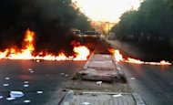 A Shaam News Network image is said to show a street blocked with burning tires during an anti-regime demonstration in Damascus on Thursday. UN chief Ban Ki-moon has warned that Syria risks a &quot;catastrophic civil war&quot; following a massacre that sparked global outrage, as the US slammed Russia for resisting UN action against Damascus