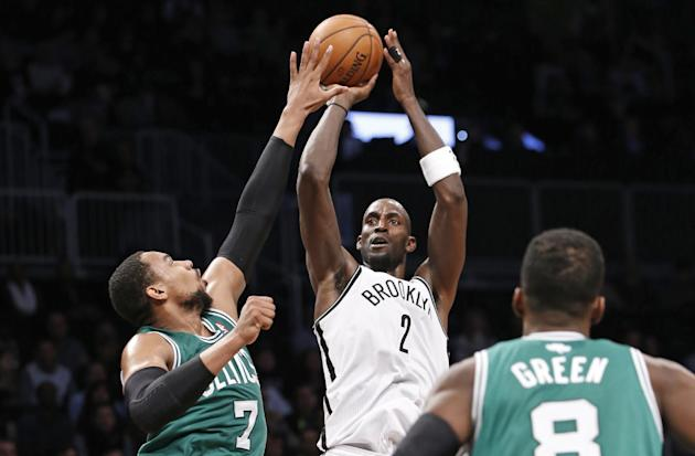 Brooklyn Nets forward Kevin Garnett (2) shoots over Boston Celtics forward Jared Sullinger (7) as Boston Celtics guard Jeff Green (8) looks on from the floor in the first half of their their NBA baske