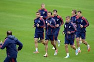 Russia&#39;s national football team players take part in a training session at the Victoria stadium in Sulejowek. The team is facing a potential six-point deduction from its next European championship qualifying campaign, after UEFA imposed a suspended punishment for its fans&#39; behaviour at Euro 2012