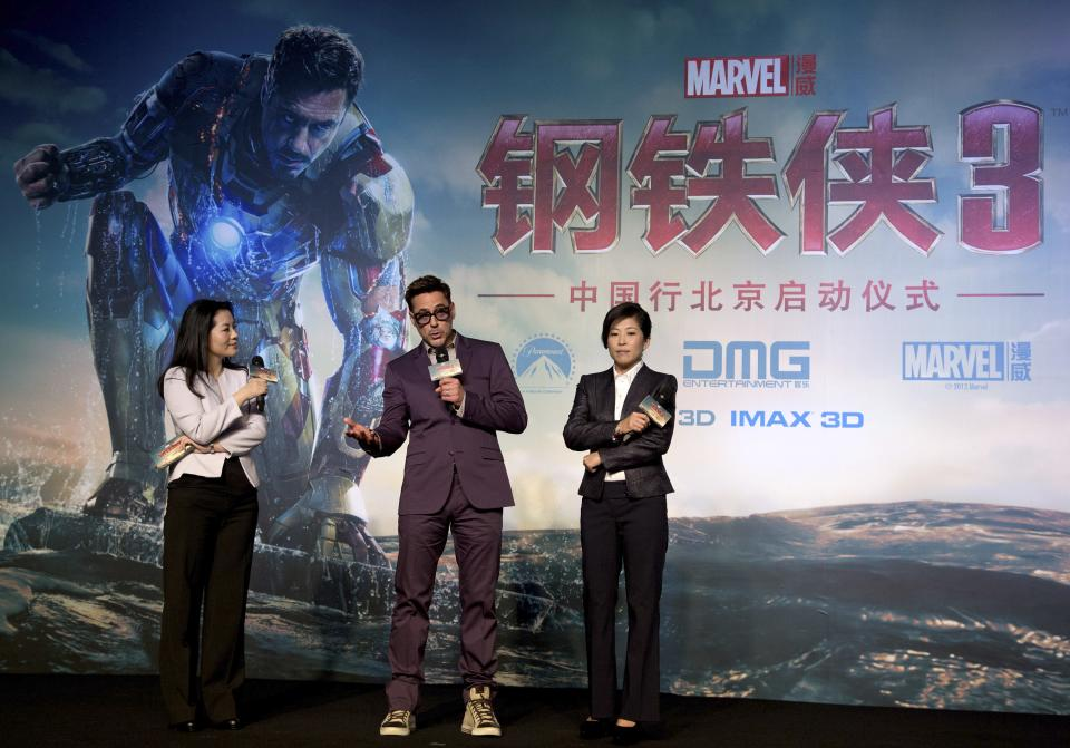 "U.S. actor Robert Downey Jr, center, speaks on stage during the world premiere event of his new movie ""Iron Man 3"" at a Beijing hotel Saturday, April 6, 2013. (AP Photo/Andy Wong)"