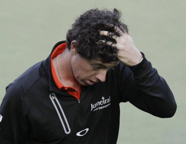 Rory McIlroy, of Northern Ireland, reacts after bogeying the 18th hole during the first round of the U.S. Open Championship golf tournament Thursday, June 14, 2012, at The Olympic Club in San Francisco. (AP Photo/Eric Risberg)