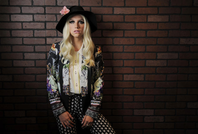 In this Tuesday, Nov. 13, 2012 photo, singer-songwriter Ke$ha poses for a portrait in Los Angeles. Her new album &quot;Warrior,&quot; released Dec. 4, flaunts the same uncouth attitude that propelled her debut &quot;Animal&quot; and EP &quot;Cannibal&quot; up the charts. Like those albums, &quot;Warrior&quot; is filled with upbeat, living-in-the-moment anthems like current single &quot;Die Young,&quot; now No. 2 on the Billboard Hot 100. (Photo by Chris Pizzello/Invision/AP)