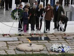 Members of the Kennedy family pay their respects at Arlington National Cemetery to mark the 50th anniversary of the assassination of former U.S. President John F. Kennedy at his gravesite in Arlington