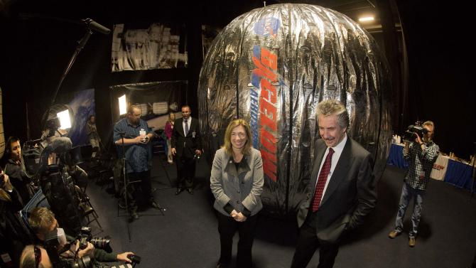 NASA deputy administrator, Lori Garver, left, and Bigelow Aerospace president Robert Bigelow, pose for photos and video in front of the Bigelow Expandable Activity Module during a news conference, Wednesday, Jan. 16, 2013, in Las Vegas. NASA awarded a contact to Bigelow Aerospace to provide NASA with the BEAM, a habitat module for the International Space Station.  (AP Photo/Julie Jacobson)