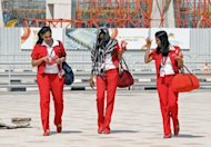 Air hostesses from India&#39;s Kingfisher Airlines leave Bangalore International Airport in February 2012. India&#39;s struggling Kingfisher Airlines said late Saturday its services would return to normal after a strike by employees over long overdue pay forced cancellation of more than three dozen flights