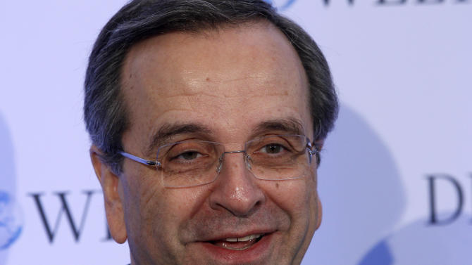 The Prime Minister of Greece, Antonis Samaras,  arrives for a closed-doors conference organized by German newspaper 'Die Welt'  in Berlin, Germany, Tuesday, Jan. 8, 2013. (AP Photo/Michael Sohn)
