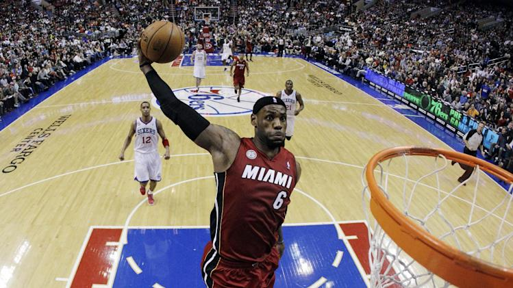 FILE - In this March 13, 2013, file photo, Miami Heat's LeBron James goes up for a dunk in the first half of an NBA basketball game against the Philadelphia 76ers in Philadelphia.  A person with knowledge of the situation tells The Associated Press that James has won the NBA Most Valuable Player award for the fourth time in five years. (AP Photo/Matt Slocum, File)