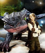 "In this undated image released by DreamWorks Animation, actor Rarmian Newton, portraying the character Hiccup, poses with Toothless the dragon from ""How to Train Your Dragon Live Spectacular."" The production will launch their North American tour on June 27, 2012 with a performance in Wilkes-Barre, Pa. (AP Photo/DreamWorks Animation, Lisa Tomasetti)"