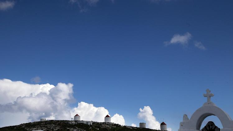 Old windmills are seen on the top of the village of Hora, in the Greek island of Amorgos on Friday April 18, 2014. (AP Photo/Dimitri Messinis)