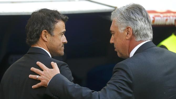 "Barcelona's coach Enrique greets Real Madrid's coach Ancelotti before their Spanish first division ""Clasico"" soccer match at the Santiago Bernabeu stadium in Madrid"